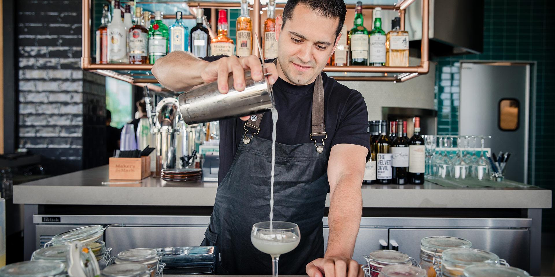 Bartender at an outdoor bar at a resort hotel