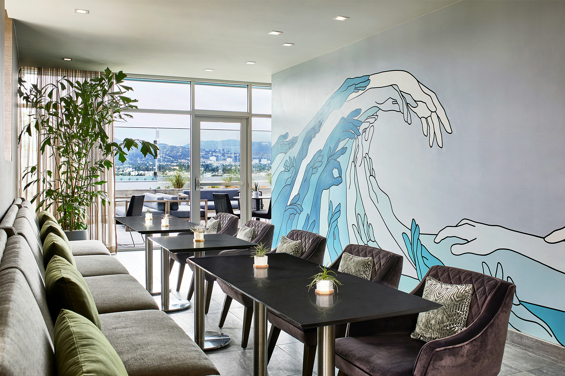AC by Marriott Beverly Hills Rooftop lounge with sea scape mural