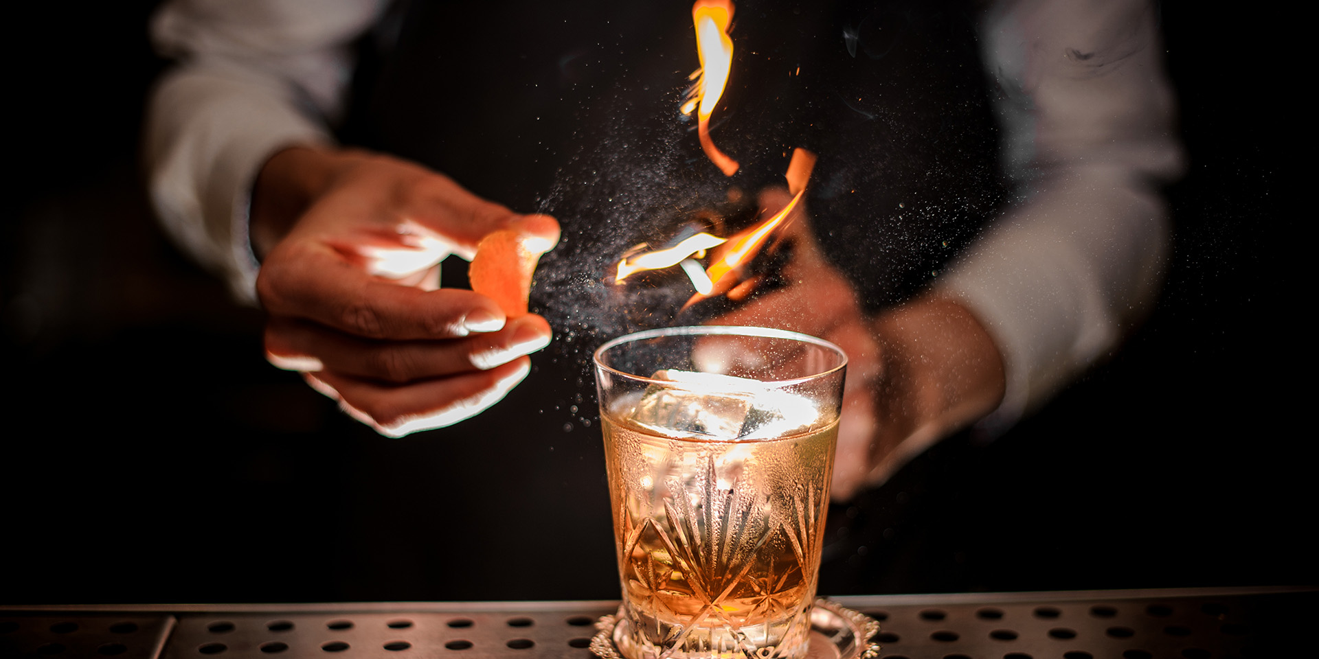 Beverage old fashioned with smoke and orange peel